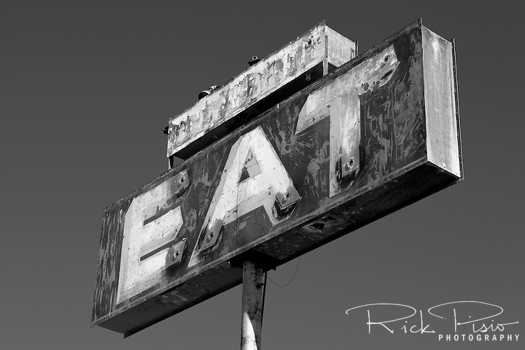 Sign for an abandoned resturaunt near Pearsonville in California's Mojave Desert along US 395.