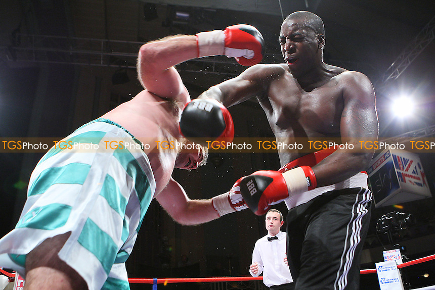Damian Campbell (black shorts) draws with Colin Kenna in a Heavyweight boxing contest at the Troxy, Limehouse, promoted by Frank Maloney - 16/10/10 - MANDATORY CREDIT: Gavin Ellis/TGSPHOTO - Self billing applies where appropriate - Tel: 0845 094 6026