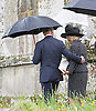 PRINCE CHARLES PUTS A COMFORTING ARM AROUND CAMILLA<br /> CAMILLA, DUCHESS OF CORNWALL AND PRINCE CHARLES<br /> attend the funeral of Mark Shand, camilla Brother who died in New York last week.<br /> Others attending the funeral included sister Annabel and family as well as his daughetr Ayesha.<br /> Also present were Andrew Parker-Bowles, Camilla former husband and Annabel Goldsmith<br /> The funeral service was held at the  Holy Trinity Church, Stourpaine in Dorset_01/05/2014<br /> Mandatory Credit Photo: &copy;Francis Dias/NEWSPIX INTERNATIONAL<br /> <br /> **ALL FEES PAYABLE TO: &quot;NEWSPIX INTERNATIONAL&quot;**<br /> <br /> IMMEDIATE CONFIRMATION OF USAGE REQUIRED:<br /> Newspix International, 31 Chinnery Hill, Bishop's Stortford, ENGLAND CM23 3PS<br /> Tel:+441279 324672  ; Fax: +441279656877<br /> Mobile:  07775681153<br /> e-mail: info@newspixinternational.co.uk