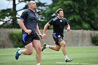 Carl Fearns and Guy Mercer in action. Bath Rugby pre-season training on July 8, 2014 at Farleigh House in Bath, England. Photo by: Patrick Khachfe/Onside Images
