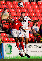 Santa Clara defender (20) Katherine Reynolds goes up for a header with Maryland forward (3) Jasmyne Spencer.  Maryland defeated Santa Clara, 1-0, at Ludwig Field in College Park Maryland.