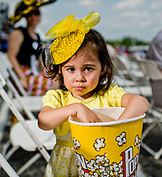 BALTIMORE, MD - MAY 19: A fan eats her popcorn while donning a fancy hat on Black-Eyed Susan Day at Pimlico Race Course on May 19, 2017 in Baltimore, Maryland.(Photo by Scott Serio/Eclipse Sportswire/Getty Images)