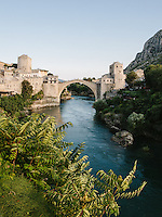 "Stari Most, translated as the ""Old Brigde"", extending at the banks of Neretva River in the Bosnian city of Mostar. The bridge was built by Mimar Hayruddin on 1566 when much of the Balkans occupied by the Ottomans. During the war between Bosnian Muslim and Bosnian Croat in this city on 1993, the bridge was destroyed. The reconstruction process was finished on 2004. Now it is a UNESCO World Heritage Site."