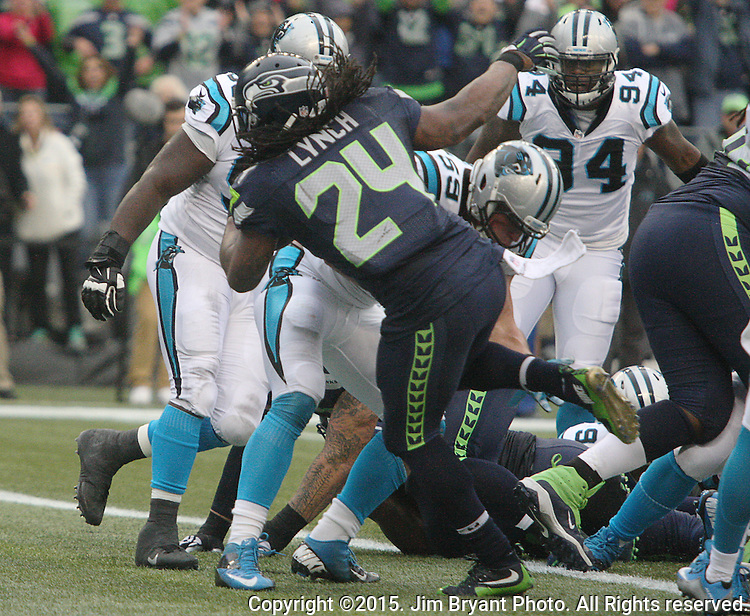 Seattle Seahawks  running back Marshawn Lynch (24) powers his way into the end zone for a 1-yard touchdown against the Carolina Panthers at CenturyLink Field in Seattle on October 18, 2015. The Panthers came from behind with 32 seconds remaining in the 4th Quarter to beat the Seahawks 27-23.  ©2015 Jim Bryant Photography. All Rights Reserved.
