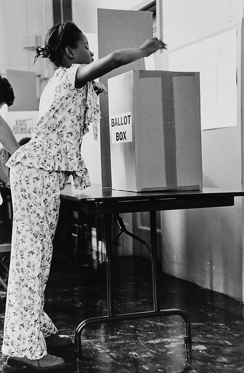 "Student at Tyler Elementary School, on Capitol Hill casts ballot in ""Mock"" election. ""Kids voting USA program on Nov. 7, 1996. (Photo by Maureen Keating/CQ Roll Call via Getty Images)"