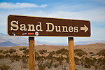 Road sign pointing to Sand Dunes at Mesquite Flat, Death Valley National Park, California