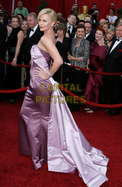 CHARLIZE THERON.The 82nd Annual Academy Awards held aat The Kodak Theatre in Hollywood, California, USA..March 7th, 2010.oscars full length pink two tone bustier bodice maxi gown couture fishtail silk satin strapless hand on hip side .CAP/EAST.©Eastman/Capital Pictures.