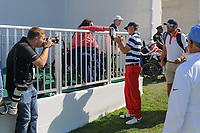 Jordan Spieth (USA) stops to sign an autograph on his way to the first tee during round 4 Singles of the 2017 President's Cup, Liberty National Golf Club, Jersey City, New Jersey, USA. 10/1/2017. <br /> Picture: Golffile | Ken Murray<br /> <br /> All photo usage must carry mandatory copyright credit (&copy; Golffile | Ken Murray)