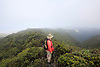 Randy Bartlett, manager of the Pu'u Kukui Watershed, walks through a bog area of the protected rainforest on West Maui, Hawaii. Photo by Kevin J. Miyazaki/Redux