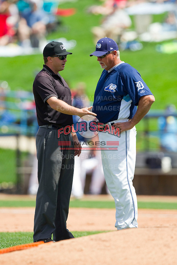 Base umpire Sean Allen explains a balk call to West Michigan Whitecaps manager Larry Parrish (15) during the Midwest League game against the Quad Cities River Bandits at Fifth Third Ballpark on May 5, 2013 in Comstock Park, Michigan.  The River Bandits defeated the Whitecaps 5-4.  (Brian Westerholt/Four Seam Images)