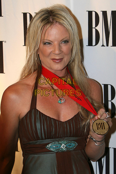 VICKY McGEHEE.55th Annual BMI Pop Music Awards held at the Regent Beverly Wilshire Hotel, Beverly Hills, California, USA..May 15th, 2007.half length medal brown green dress .CAP/ADM/CH.©Charles Harris/AdMedia/Capital Pictures