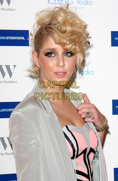 ESMEE DENTERS  .MTV Staying Alive Foundation Dinner at the Westbury Hotel, Mayfair, London - .January 27th, 2011.half length grey gray jacket hand pink dress black ring.CAP/ROS.©Steve Ross/Capital Pictures