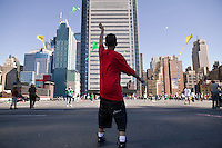 A boy (C) flies a kite from the rooftop of the Port Authority bus terminal in New York City, USA, during the third annual Kite Flight event, 23 September 2007.