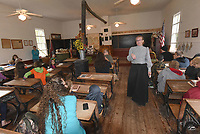 NWA Democrat-Gazette/FLIP PUTTHOFF<br />ONE ROOM SCHOOL<br />Cathy Orr with the Rogers Historical Museum teaches class Wednesday Oct. 11 2017 at the one-room Rocky Branch School east of Rogers near Beaver Lake. Area students from Connections Academy, a tuition-free online public school, attended the historic school Wednesday and pretended they were in class during 1905. Lessons included a spelling bee, reading lessons and old-time games played at recess.