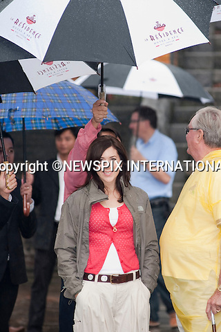 "Queen Margrethe, Crown Prince Fredrik and Crown Princess Mary and Prince Consort Henrik .The Danish Royal Family on their State Visit to Vietnam visit the Minh Manh Tomb in torrential downpour. The Hue area of Vietnam has experienced severe flooding and storms in the last 48 hours with many dead._Hue, Vietnam_05/11/2009..Mandatory Photo Credit: ©Dias/Newspix International..**ALL FEES PAYABLE TO: ""NEWSPIX INTERNATIONAL""**..PHOTO CREDIT MANDATORY!!: NEWSPIX INTERNATIONAL(Failure to credit will incur a surcharge of 100% of reproduction fees)..IMMEDIATE CONFIRMATION OF USAGE REQUIRED:.Newspix International, 31 Chinnery Hill, Bishop's Stortford, ENGLAND CM23 3PS.Tel:+441279 324672  ; Fax: +441279656877.Mobile:  0777568 1153.e-mail: info@newspixinternational.co.uk"