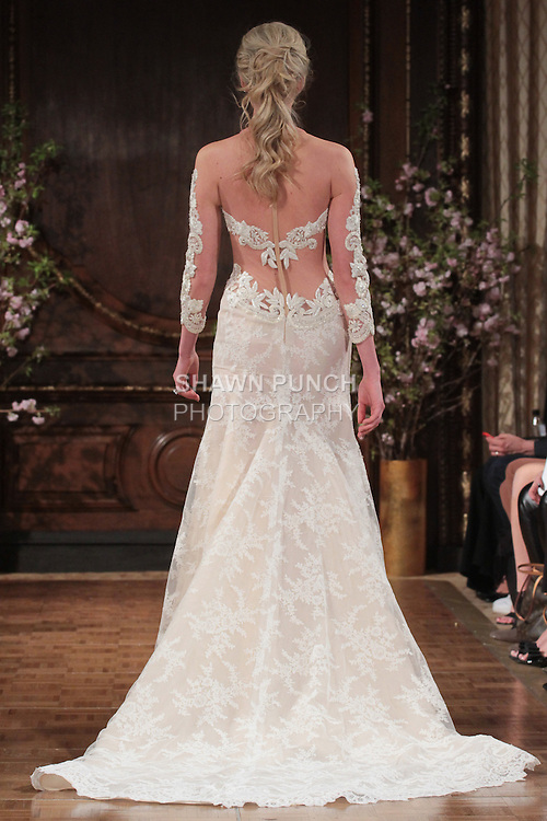 """Model walks runway in a """"Quinn"""" bridal gown from the Isabelle Armstrong Spring Collection 2017, at Lotte New York Palace Hotel, during New York Bridal Fashion Week Spring Summer 2017 on April 16, 2017."""