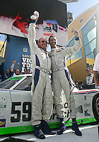 Hurley Haywood, left, and Joao Barbosa celebrate their win in the Grand Prix of Miami, Homestead-Miami Speedway, Homestead, FL, October 10, 2009. (Photo by Brian Cleary/www.bcpix.com).