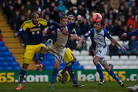 Saturday 25 January 2014<br /> Pictured( left )  Ashley Williamshas his eye on the ball as he tries to get past Mitch Hancox ( 2nd left )  <br /> Re: Birmingham City v Swansea City FA Cup fourth round match at St. Andrew's Birimingham