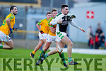 Denis Daly South Kerry in action against Jamie O'Sullivan Legion at the Kerry County Senior Football Final at Fitzgerald Stadium on Sunday.
