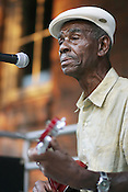 John Dee Holeman performs at West Village in Durham, NC, in August of 2005.