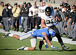 November 4, 2017:  Army West Point running back, Darnell Woolfolk #33, is brought down near the sideline following a long gain during the NCAA Football game between the Army West Point Black Knights and the Air Force Academy Falcons at Falcon Stadium, United States Air Force Academy, Colorado Springs, Colorado.  Army West Point defeats Air Force 21-0.