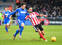 Lincoln City's Jordan Williams shields the ball from Notts County's Matt Tootle<br /> <br /> Photographer Andrew Vaughan/CameraSport<br /> <br /> The EFL Sky Bet League Two - Lincoln City v Notts County - Saturday 13th January 2018 - Sincil Bank - Lincoln<br /> <br /> World Copyright &copy; 2018 CameraSport. All rights reserved. 43 Linden Ave. Countesthorpe. Leicester. England. LE8 5PG - Tel: +44 (0) 116 277 4147 - admin@camerasport.com - www.camerasport.com