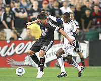 Jaime Moreno #99 of D.C. United shields the ball from Niouky Desire #23 of the New England Revolution during an MLS match on April 3 2010, at RFK Stadium in Washington D.C.