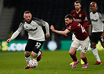 Wayne Rooney of Derby County turns Paul Anderson of Northampton during the FA Cup match at the Pride Park Stadium, Derby. Picture date: 4th February 2020. Picture credit should read: Darren Staples/Sportimage