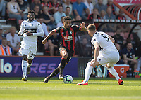 Fulham's Calum Chambers (right) vies for possession with Bournemouth's Junior Stanislas (centre)<br /> <br /> Photographer David Horton/CameraSport<br /> <br /> The Premier League - Bournemouth v Fulham - Saturday 20th April 2019 - Vitality Stadium - Bournemouth<br /> <br /> World Copyright © 2019 CameraSport. All rights reserved. 43 Linden Ave. Countesthorpe. Leicester. England. LE8 5PG - Tel: +44 (0) 116 277 4147 - admin@camerasport.com - www.camerasport.com