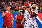 6 October 2017: Washington Nationals outfielder Jayson Werth gets a hug from Mascot Screech during the team introduction ceremony, prior to the start of the NLDS against the Chicago Cubs at Nationals Park in Washington, DC. The Cubs shut out the Nationals 3-0 to take a 1-0 lead in their best of five Postseason series. Mandatory Credit: Ed Wolfstein Photo *** RAW (NEF) Image File Available ***