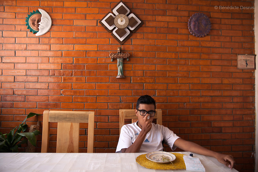 "Baruch takes his medicine at his home in the Iztapalapa area of Mexico City, Mexico on July 8, 2014. Baruch Alejandro Anleu Ramirez, 18, is the captain of Guerreros Aztecas. Two years ago, Baruch had his left leg amputated due to bone cancer. He used to practice as much as his chemotherapy would allow. Expelled from school for missing too many classes during his treatment, he says, ""Guerreros Aztecas has filled a big hole in my life"". Baruch was Guerreros Aztecas's brightest hope to represent Mexico at the Amputee Soccer World Cup. But since the cancer's spread to his lungs, he can no longer play or train with the team. Guerreros Aztecas (""Aztec Warriors"") is Mexico City's first amputee football team. Founded in July 2013 by five volunteers, they now have 23 players, seven of them have made the national team's shortlist to represent Mexico at this year's Amputee Soccer World Cup in Sinaloa this December. The team trains twice a week for weekend games with other teams. No prostheses are used, so field players missing a lower extremity can only play using crutches. Those missing an upper extremity play as goalkeepers. The teams play six per side with unlimited substitutions. Each half lasts 25 minutes. The causes of the amputations range from accidents to medical interventions – none of which have stopped the Guerreros Aztecas from continuing to play. The players' age, backgrounds and professions cover the full sweep of Mexican society, and they are united by the will to keep their heads held high in a country where discrimination against the disabled remains widespread. (Photo by Bénédicte Desrus)"