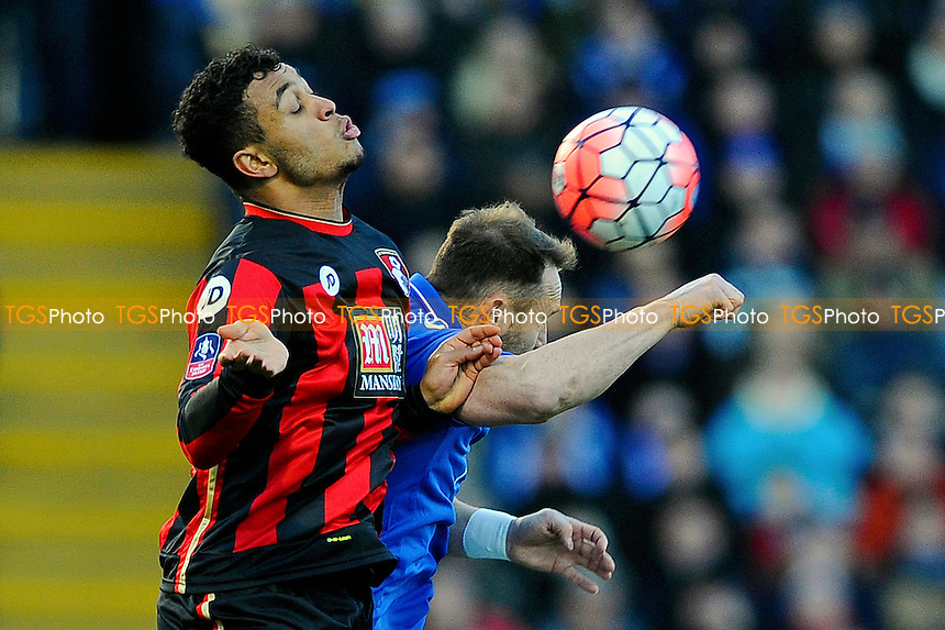 Ben Davies of Portsmouth wins a header from Joshua King of AFC Bournemouth during Portsmouth vs AFC Bournemouth, Emirates FA Cup Football at Fratton Park
