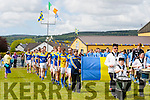 The teams march around the field  at the opening of the Cordal GAA pitch on Sunday