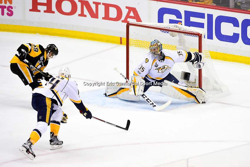 May 29, 2017: Nashville Predators goalie Pekka Rinne (35) watches for the shot from Pittsburgh Penguins center Jake Guentzel (59) during game one of the National Hockey League Stanley Cup Finals between the Nashville Predators  and the Pittsburgh Penguins, held at PPG Paints Arena, in Pittsburgh, PA. Pittsburgh defeats Nashville 5-3 in regulation time.  Eric Canha/CSM