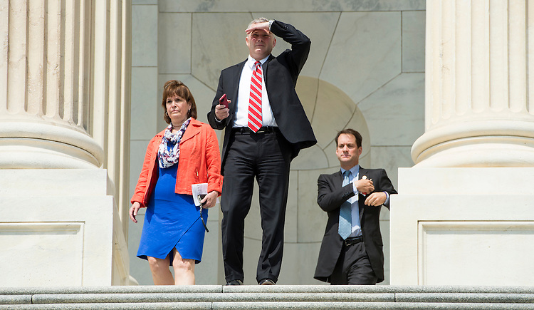 UNITED STATES - JULY 11: Rep. Tim Griffin, R-Ark., leaves the Capitol following a vote on Friday, July 11, 2014. (Photo By Bill Clark/CQ Roll Call)