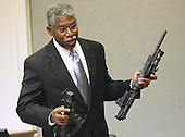 Bureau of Alcohol, Tobacco, and Firearms (ATF) agent Walter A. Dandridge Jr., holds the bushmaster rifle used in the sniper shootings during his testimony during the trial of Sniper Suspect John Allen Muhammad in Virginia Beach Circuit Court in Virginia Beach, Virginia, November 6, 2003.<br /> Credit: Tracy Woodward - Pool via CNP