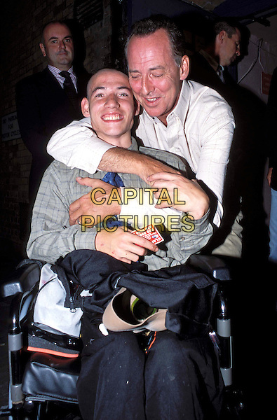 MICHAEL BARRYMORE.Michael Barrymore - The Kings Of Comedy press night - Wyndham Theatre.hugging, kissing, fan in wheelchair.www.capitalpictures.com.sales@capitalpictures.com.© Capital Pictures