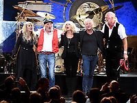 NEW YORK - JANUARY 26: (L-R) Stevie Nick, John McVie, Christine McVie, Lindsey Buckingham, and Mick Fleetwood of Fleetwood Mac appear at the 2018 MusiCares Person of the Year honoring Fleetwood Mac at Radio City Music Hall on January 26, 2018 in New York City. (Photo by Frank Micelotta/PictureGroup)