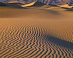 Death Valley National Park, CA<br /> Rippled patterns on the Mesquite Flats Sand Dunes near Stove Pipe Wells under the distant wall of the Grapevine mountains