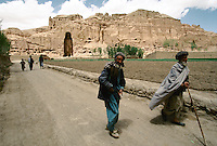 Localâs gathering to the mosque for the holy Friday pray, in the front of the Bamiyan Buddha of 54 meters high, in 1995..These magnificent colossal statues, created during the 3rdâ4th centuries A.D., attracted pilgrims for centuries, far beyond the time when Buddhism languished in India following the disastrous visitation of the Hephthalite Huns in the 5th century, the subsequent resurgence of Hinduism, and the arrival of iconoclastic Islam in the 7th century..The entire niche was once covered with paintings dating from i he late 5th to the early 7th centuries.