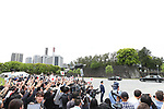 Well-wishers cheer and wave as a vehicle carrying Japan's new Emperor Naruhito leaves the Imperial Palace in Tokyo, Japan on May 1, 2019, the first day of the Reiwa Era. (Photo by Yohei Osada/AFLO)