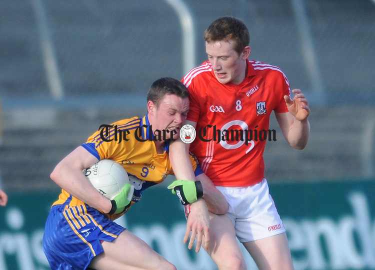 Aidan Malone of Clare runs into the challenge of Cork's Damien Cahalan. Photograph by Declan Monaghan
