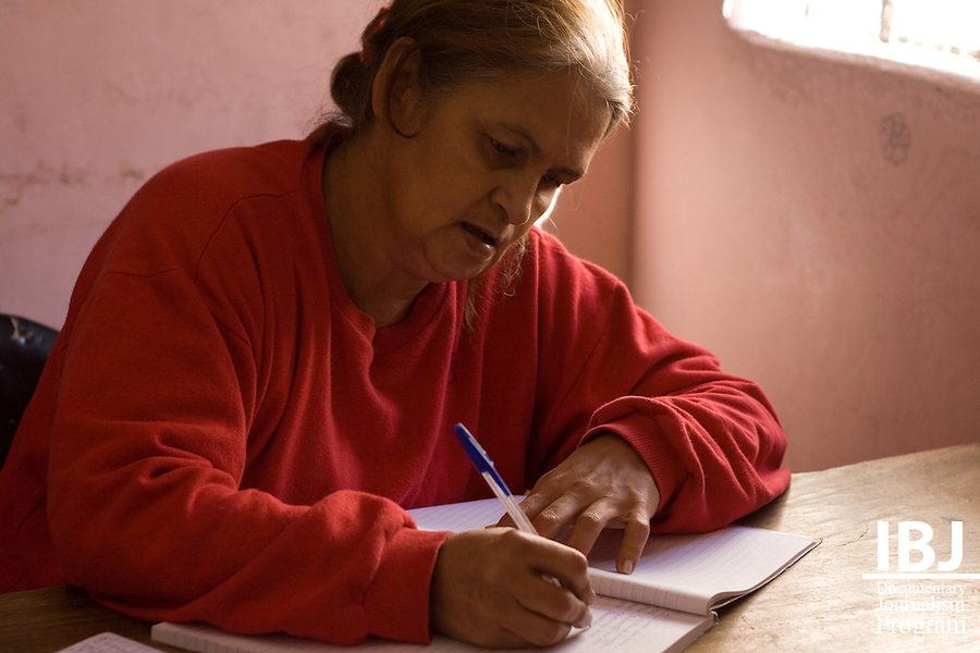 A woman at Floramar Prison in Divinopolis, Brazil writes in a journal practicing basic skills in literacy where materials such as pens, textbooks and notebooks are donated. IBJ Fellow Dr. Aziz Saliba is programming educational material to reach this prison and many others in Brazil informing local communities about their rights to habeas corpus which protects the accused from illegal internment.