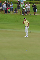 Takumi KANAYA (JPN) attempts to help his putt up the hill on 18 during Rd 4 of the Asia-Pacific Amateur Championship, Sentosa Golf Club, Singapore. 10/7/2018.<br /> Picture: Golffile | Ken Murray<br /> <br /> <br /> All photo usage must carry mandatory copyright credit (© Golffile | Ken Murray)