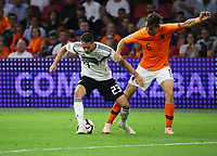 Mark Uth (Deutschland Germany) gegen Marten de Roon (Niederlande, Netherlands) - 13.10.2018: Niederlande vs. Deutschland, 3. Spieltag UEFA Nations League, Johann Cruijff Arena Amsterdam, DISCLAIMER: DFB regulations prohibit any use of photographs as image sequences and/or quasi-video.
