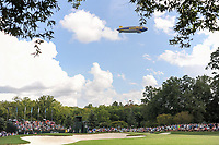 The Goodyear blimp flies over Rickie Fowler (USA), Paul Casey (GBR), and Justin Thomas (USA) putting on 10 during Saturday's round 3 of the PGA Championship at the Quail Hollow Club in Charlotte, North Carolina. 8/12/2017.<br /> Picture: Golffile | Ken Murray<br /> <br /> <br /> All photo usage must carry mandatory copyright credit (&copy; Golffile | Ken Murray)