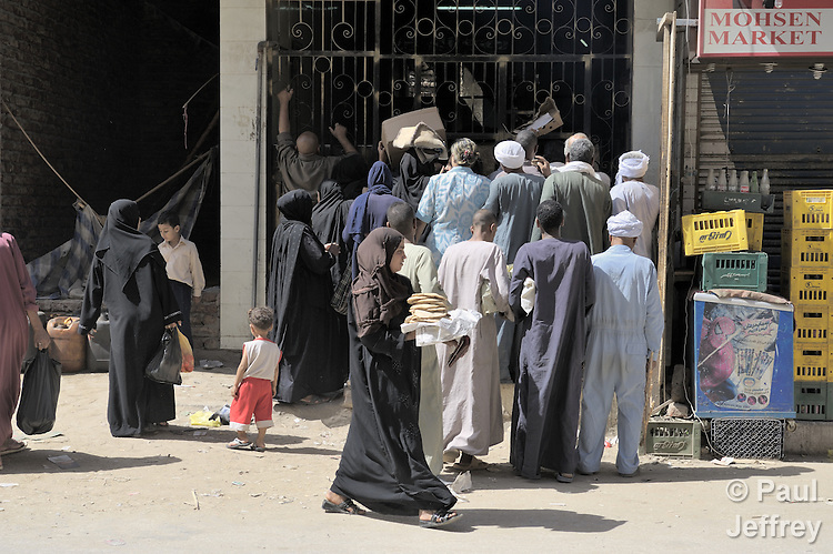 A line outside a bread store in the Egyptian town of Luxor. Riots have broken out recently in Egypt over the shortage and high price of bread.