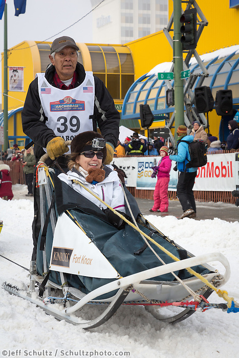 Rudy Demoski  Sr. and team leave the ceremonial start line at 4th Avenue and D street in downtown Anchorage during the 2013 Iditarod race. Photo by Jim R. Kohl/IditarodPhotos.com
