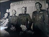 BNPS.co.uk (01202 558833)<br /> Pic: Marlows/BNPS<br /> <br /> Many high ranking Nazi's were in attendance.<br /> <br /> Taken just three days before D-Day this remarkable photo shows Adolf Hitler celebrating the wedding of his brother-in-law - who he had executed a year later.<br /> <br /> The previously unseen image shows the Nazi dictator congratulating Hermann Fegelein and bride Gretl Braun, little realising that the course of the Second World War was about to turn against him.<br /> <br /> It was found in a gallery of 12 snaps of the wedding reception that lasted for thee days and was organised by Eva Braun, the elder sister of Gretl and Hitler's mistress.<br /> <br /> The fuhrer was one of the witnesses to the marriage along with SS chief Heinrich Himmler and Martin Bormann, Hitler's private secretary.<br /> <br /> The 12 black and white photos taken at her first wedding have sold at Marlows auctioneers of Stafford for &pound;400.