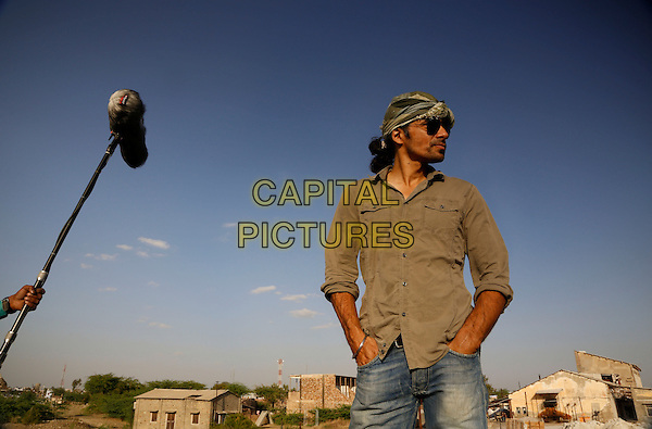 Imtiaz Ali (director)<br /> on the set of Highway (2014) <br /> *Filmstill - Editorial Use Only*<br /> CAP/NFS<br /> Image supplied by Capital Pictures